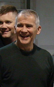 Portrait of Oliver North (click to view image source)