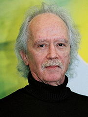 Portrait of John Carpenter (click to view image source)