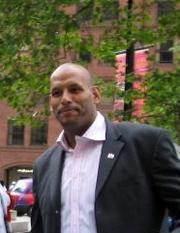 Portrait of John Amaechi (click to view image source)