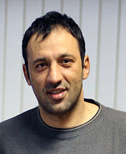 Portrait of Vlade Divac (click to view image source)