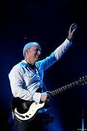 Portrait of Mark Knopfler (click to view image source)