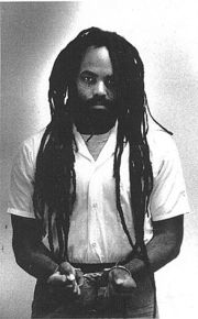 Portrait of Mumia Abu-Jamal (click to view image source)