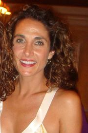 Portrait of Melina Kanakaredes (click to view image source)