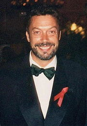 Portrait of Tim Curry (click to view image source)