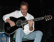 Portrait of Al Di Meola (click to view image source)